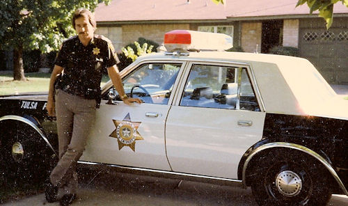 Tom Vallely and Tulsa Police 1986 Plymouth Fury.