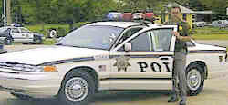 Tom in a 1996 Tulsa Police Ford Crown Vic